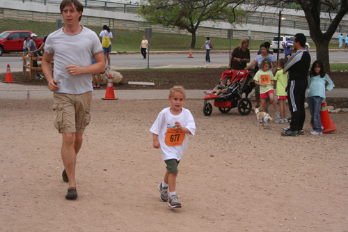 Luke runs toward the finish line in the Junior Dillo